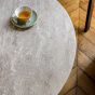 Carlotta coffee table, travertine top and cream white lacquered legs